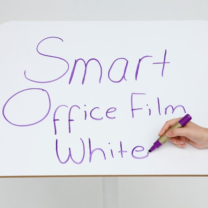 Smart-Self-Adhesive-Whiteboard-Film-applied-to-desk-to-create-dry-erase-surface