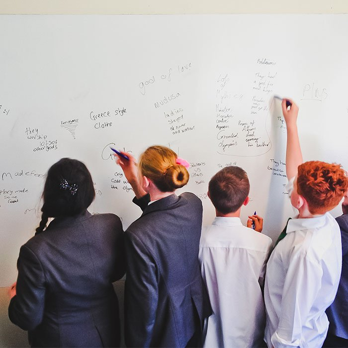 students-in-school-using-dry-erase-surface-in-lessons-painted-in-Smarter-Surfaces-Smart-Whiteboard-Paint