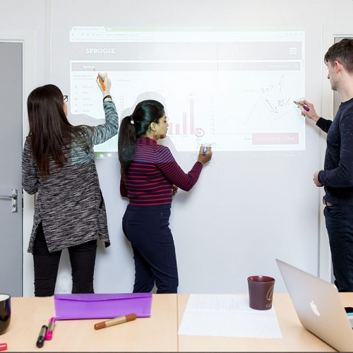Simultaneously-writing-and-projecting-on-Smart-Whiteboard-Wallpaper-Low-Sheen-projector-whiteboard-surfaces