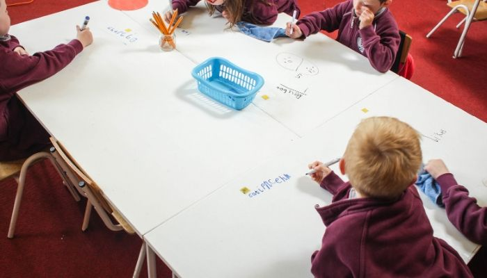 children-writing-on-desks-with-dry-erase-whiteboard-paint