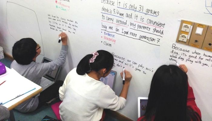 children-writing-on-whiteboard-wall-painted-in-dry-erase-whiteboard-paint