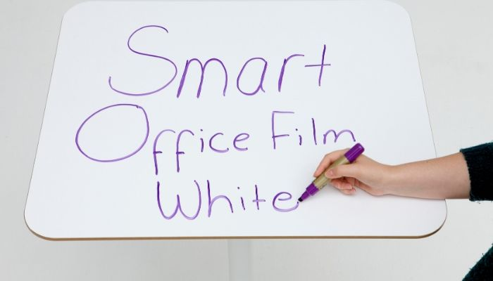 Smart-Self-Adhesive-Whiteboard-Film-applied-to-desk-stick-on-whiteboard