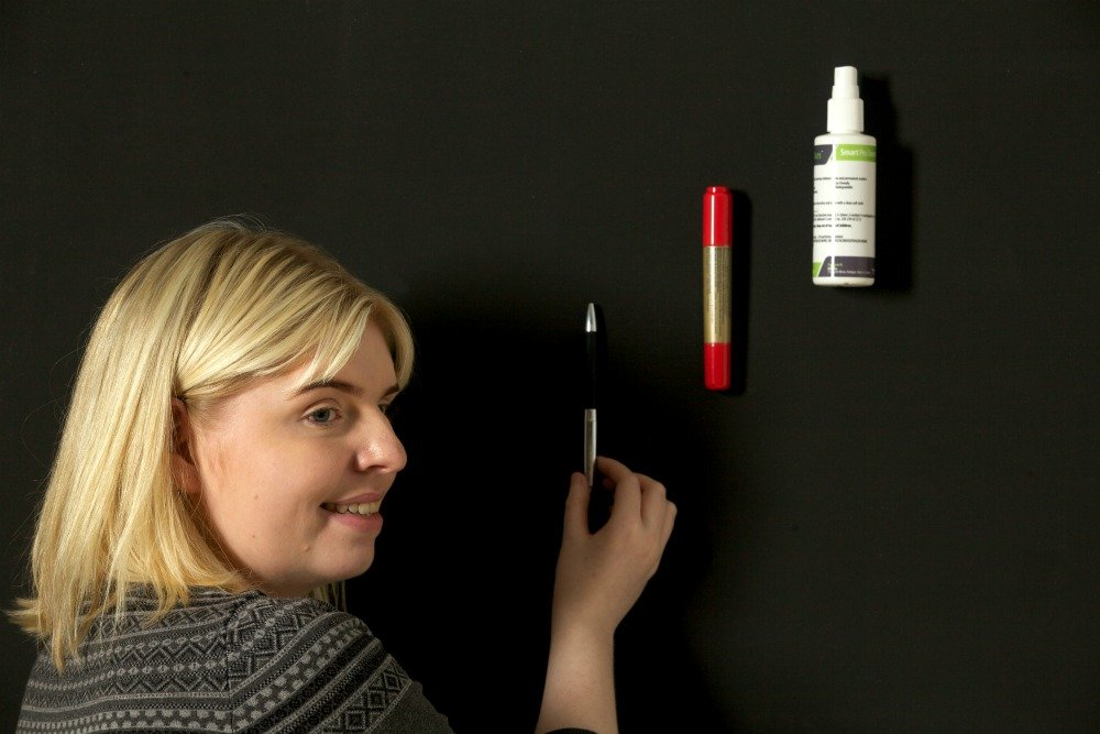 whiteboard marker on a magnetic wall using magnetic strips