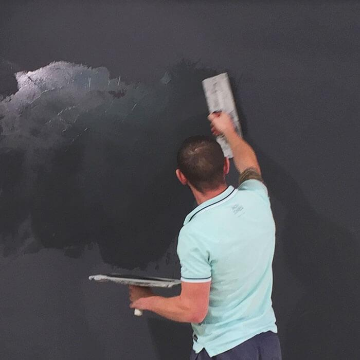 Contractor applying magnetic plaster to wall