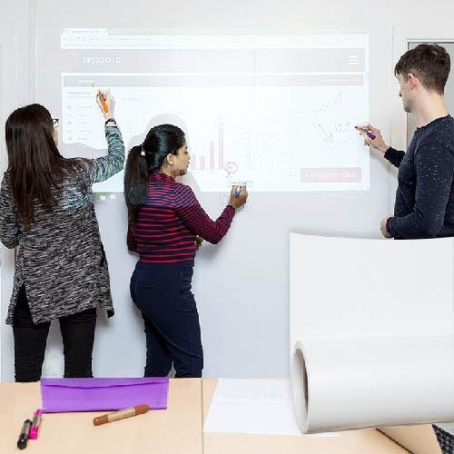People using projection surfaces and whiteboard for meetings