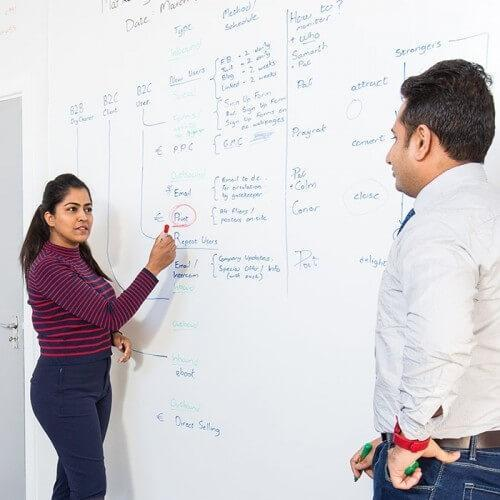 Woman using Smart Whiteboard Wallpaper Low Sheen during a conference