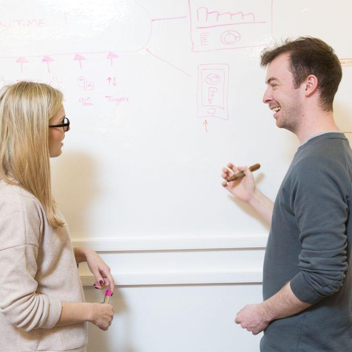 a-dry-erase-wall-covering-being-used-in-meeting-room
