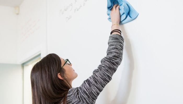 woman-writing-on-whiteboard-roll-material